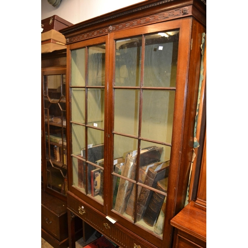 1433 - George III mahogany bookcase, the moulded dentil cornice above two astragal glazed doors, the base w...