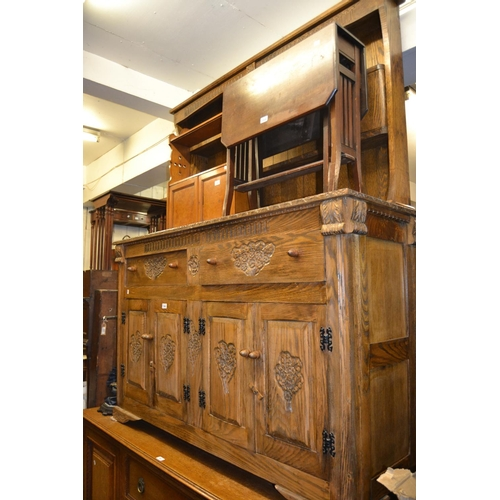 1442 - Reproduction oak dresser with a boarded shelf back above drawers and cupboards...