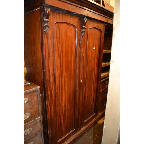1466 - 19th Century mahogany three door wardrobe, the moulded cornice above long panel doors with carved de...