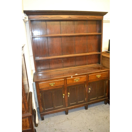 1469 - 19th Century oak dresser, the boarded shelf back above three drawers and three panelled doors on sti...