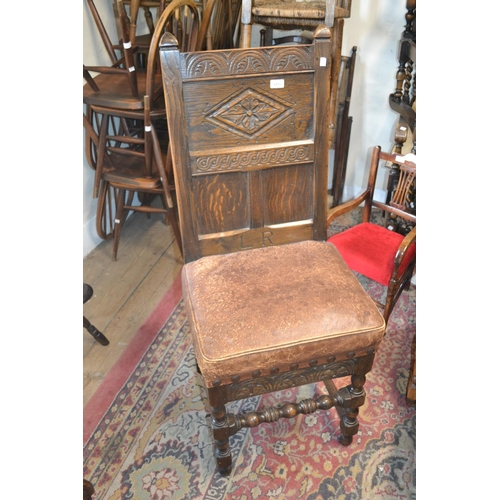 1470 - Reproduction oak side chair in 17th Century style with a carved panelled back on turned front suppor...