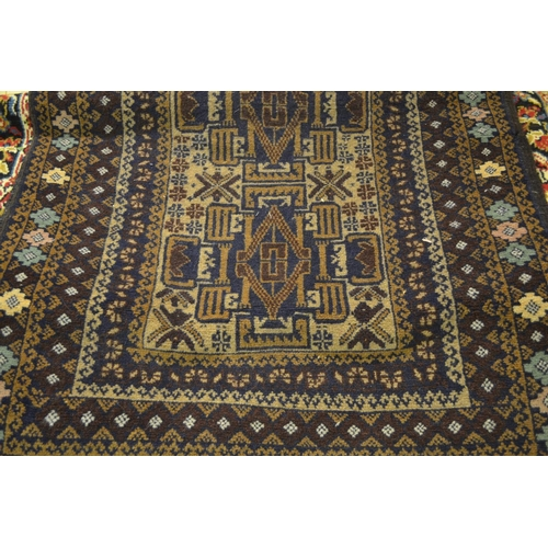 15 - Small rug having single row of three medallions with multiple borders on beige and brown ground, 4ft...
