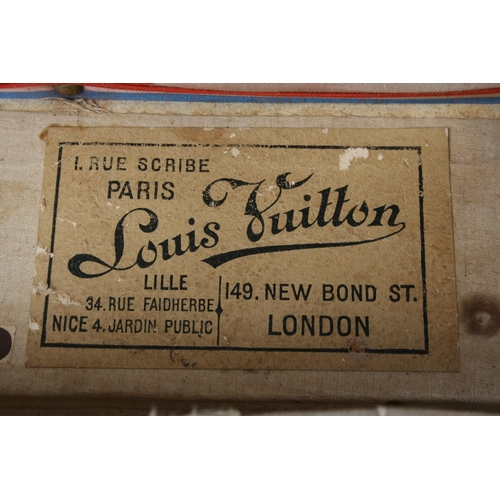 1670 - Louis Vuitton steamer trunk, circa 1900, with original canvas and wooden strapping and original bras...