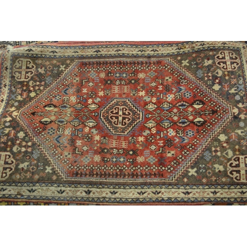 19 - Small 20th Century Qashqai rug with a medallion and floral design on a rose ground with borders, tog...