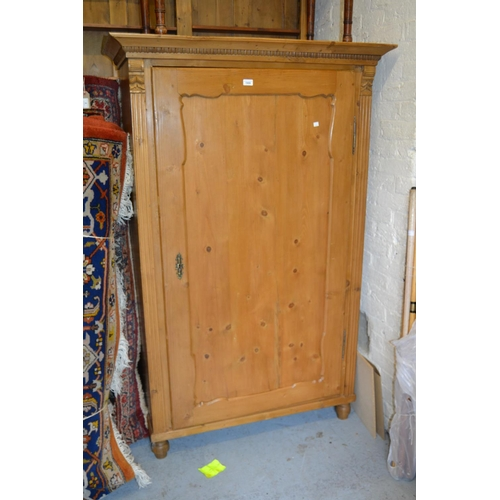 1909 - Pair of 19th Century Continental stripped and polished pine wardrobes, each with a moulded cornice a...