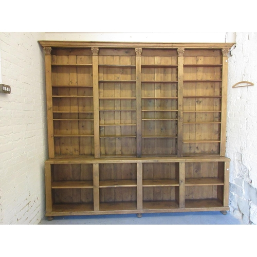 1923A - Large stripped and polished pine dresser / bookcase with moulded cornice above an arrangement of ope...