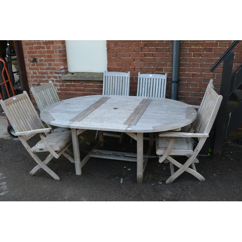 1953 - Good quality modern teak circular extending garden table by Westminster, together with six matching ...