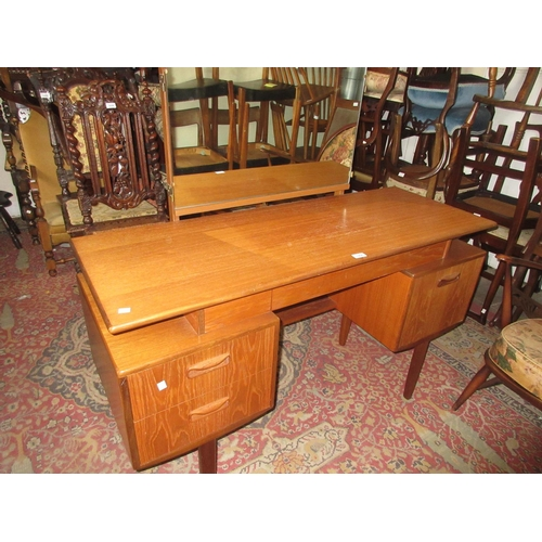 1954 - Mid 20th Century G-plan teak dressing table with a triple section mirror above a jewel drawers, two ...