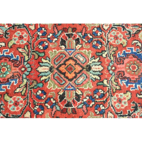 2 - Large Mahal carpet with an all-over stylised floral design on a rose ground with borders (some moth ...