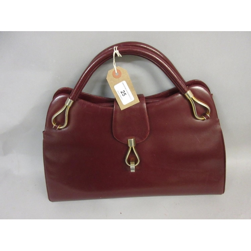 25 - Ladies burgundy leather handbag by Dunhill...