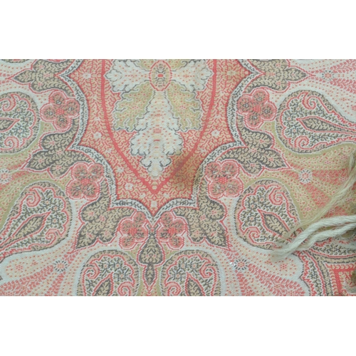 26 - Late 19th or early 20th Century Paisley shawl woven in shades of predominantly red, black, green and...