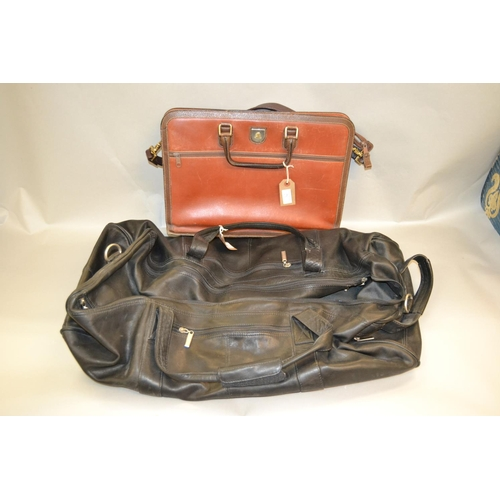 28 - Black leather holdall and a small attache case...