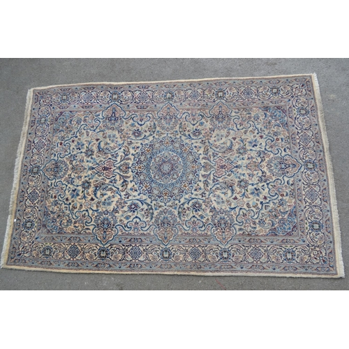 3 - Indo Persian rug with a medallion and all-over floral design on an ivory ground with borders...