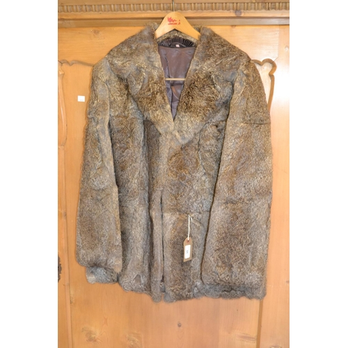 31 - Ladies fur jacket together with a ladies three quarter length dark brown fur coat...
