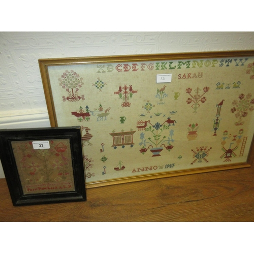 33 - Small 19th Century needlework sampler in an ebonised frame, 6ins x 5ins and a larger framed needlewo...