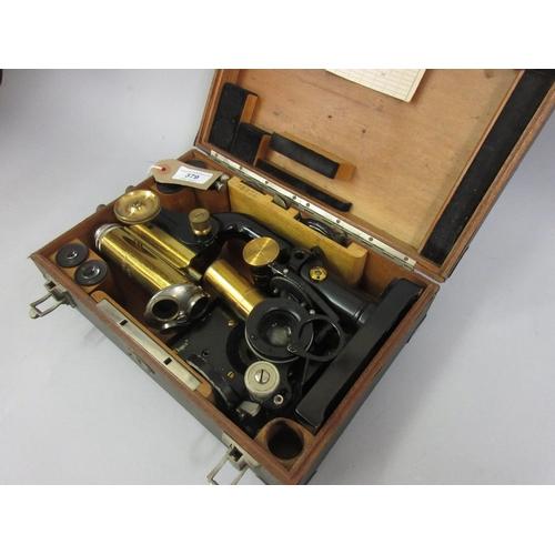 379 - C. Reichert, Austrian gilt brass and black japanned monocular microscope, numbered 68424, in origina...