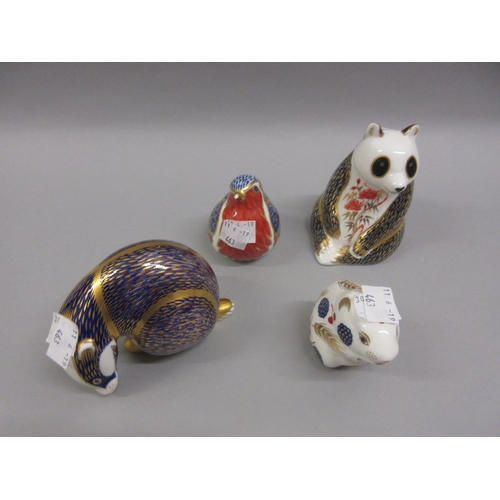 463 - Group of four various Royal Crown Derby paperweights (the group including the robin is at fault)...