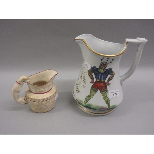 479 - 19th Century English pottery puzzle / trick jug, together with a 19th Century creamware jug...