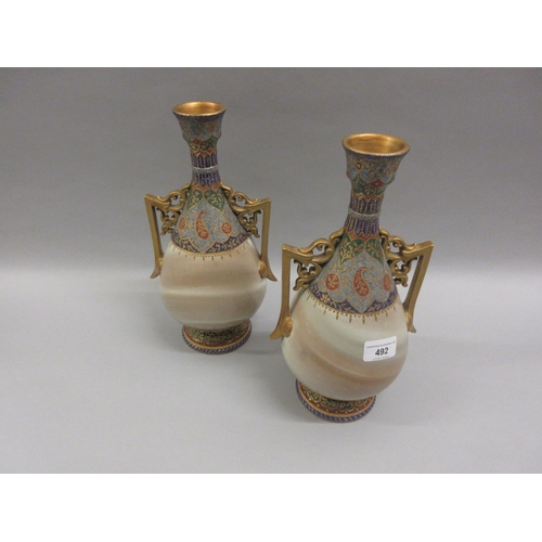 492 - Pair of Continental pottery two handled vases decorated in blue, green and gilt with simulated stone...