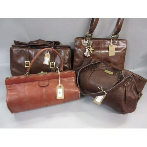 51 - Pink leather Gladstone bag together with three brown leather handbags...