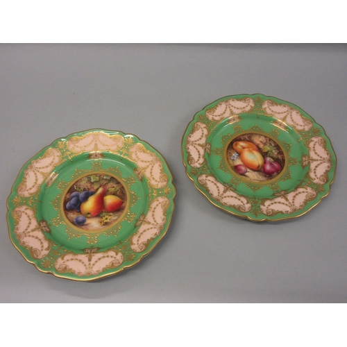 577 - Pair of Royal Worcester plates, hand painted with various fruits by R. Seabright in circular central...