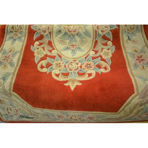 6 - Chinese deep pile all-over floral decorated rug on a beige and red ground, together with a similar s...