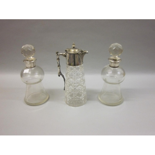 622 - Pair of thistle shaped glass decanters with silver collars together with a cut glass claret jug with...