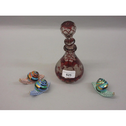 625 - Three Herend porcelain figures of snails (at fault), together with a Bohemian red overlay decanter (...