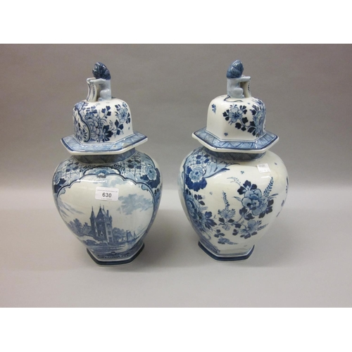 630 - Pair of large early 20th Century Delftware jars with covers...