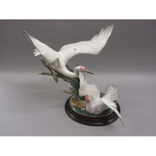 638 - Large Lladro group of two cranes with outstretched wings beside bullrushes, 21ins high, including th...