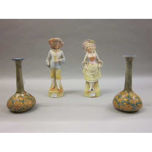 641 - Pair of Royal Doulton stoneware bottle vases together with a pair of bisque figures...