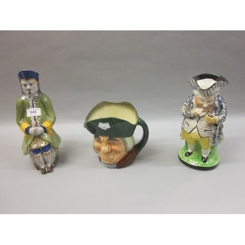 648 - French Quimper pottery Toby jug together with an English pottery Toby jug and a Royal Doulton charac...