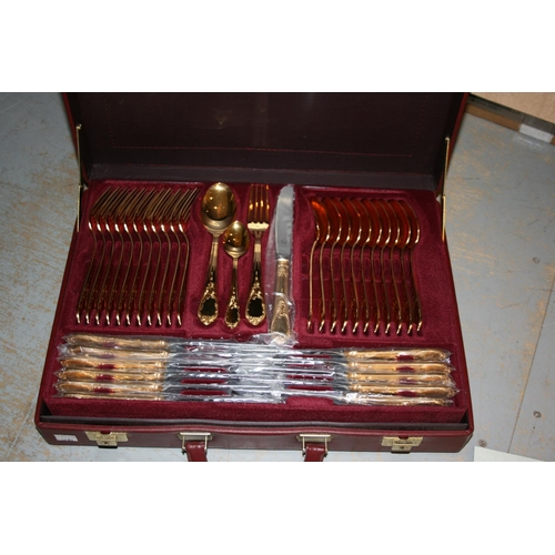 661 - German twelve place setting canteen of gold plated cutlery with original carry case...