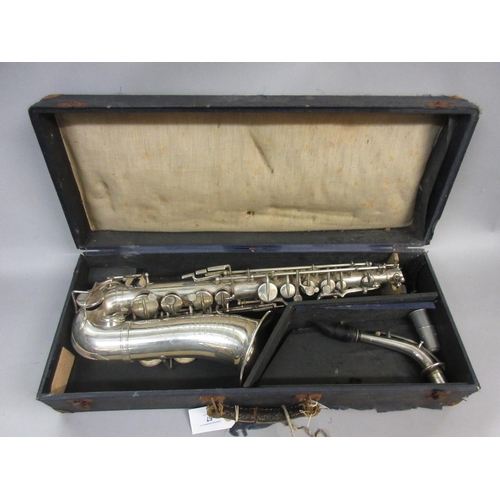 67 - Silver plated saxophone inscribed to the bell Rene Guenot, A Douchet and Cie, 35 Rue Claval, Paris, ...