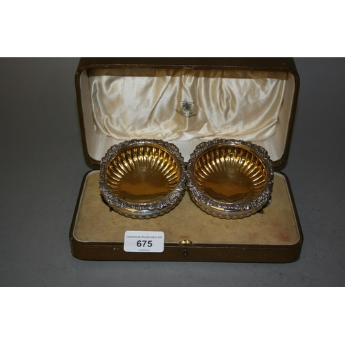 675 - Cased pair of George IV silver salts with gilded interiors, London 1825...