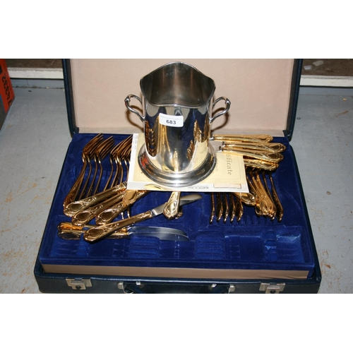 683 - Silver plated two handled bottle cooler and a gold plated canteen of cutlery in fitted case...