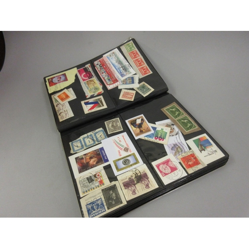 69 - Album containing a collection of approximately five hundred World postage stamps...
