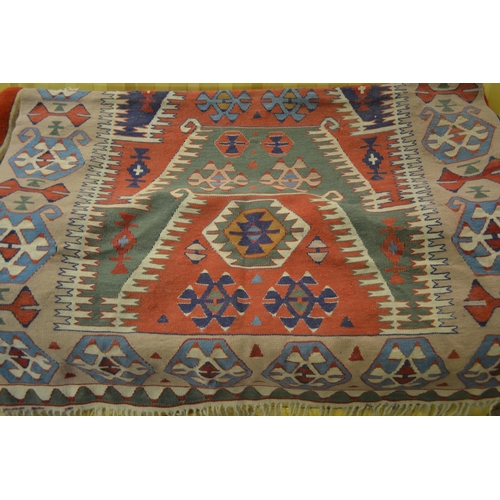 7 - 20th Century Kelim rug with all-over geometric pattern on a cream and wine ground, together with ano...