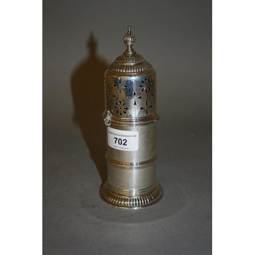 702 - Circular silver sugar caster, London, 1929...