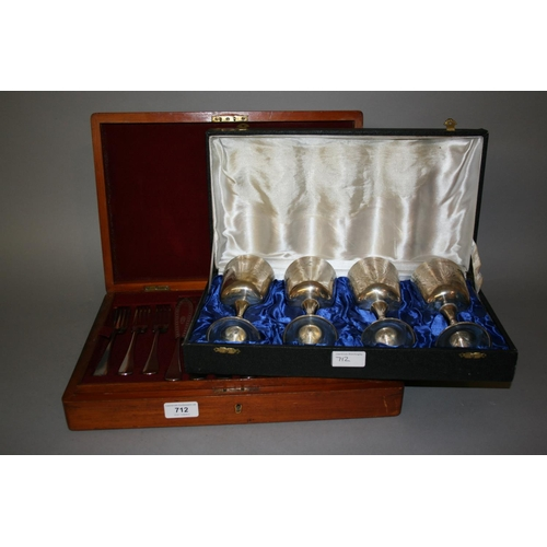 712 - Cased set of twelve silver plated fish knives and forks together with a cased set of four silver pla...