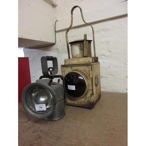 74 - Two metal railway lamps...
