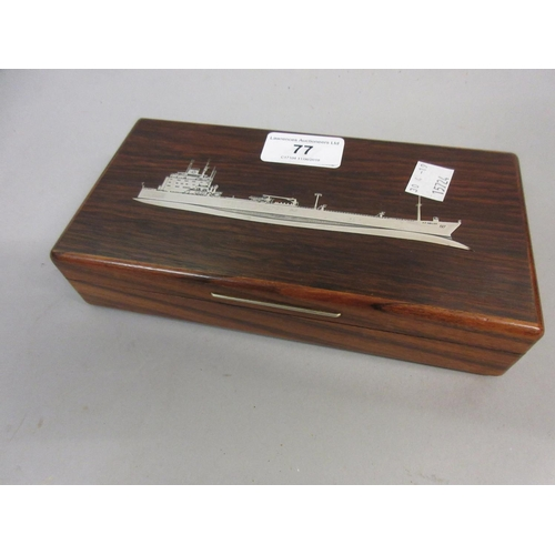 77 - Mid 20th Century rosewood cigarette box, the cover inlaid with a ship...