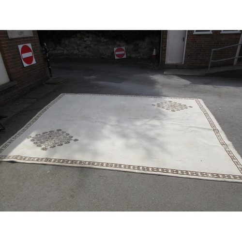 8 - Large Tunisian woollen carpet of floral design with border on a beige ground, 13ft x 10ft...