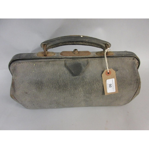 90 - Leather Gladstone type Doctor's bag, an A.A. car badge, amber cigar holder and sundries...