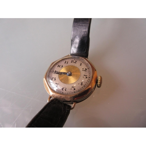 905 - Ladies 9ct gold cased wristwatch having silvered chapter ring, Arabic numerals and later leather str...