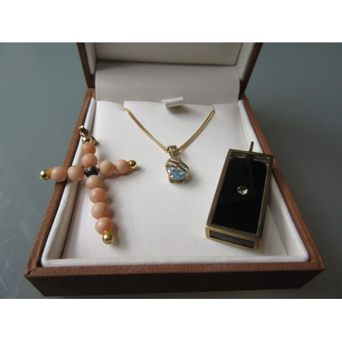 909 - 9ct Gold pendant on a 9ct gold chain, a coral bead pendant and a 9ct gold diamond set pendant...