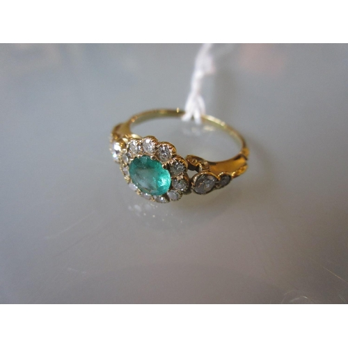 911 - 18ct Yellow gold flower head ring set emerald and diamonds...