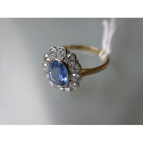 912 - 18ct Yellow gold oval sapphire and diamond cluster ring...