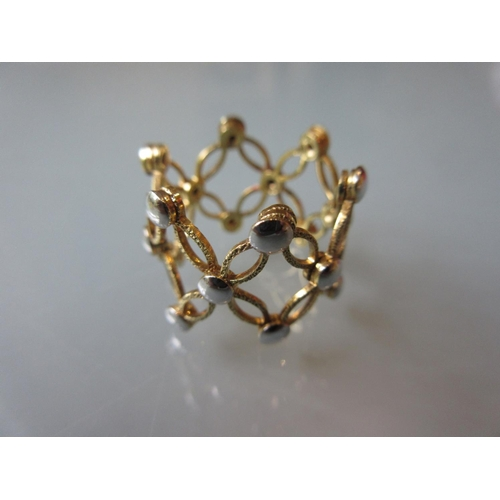 916 - 18ct Two colour gold ring of pierced design...