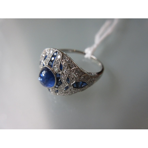 922 - Art Deco style platinum dress ring set diamonds and sapphires with a central cabochon sapphire...